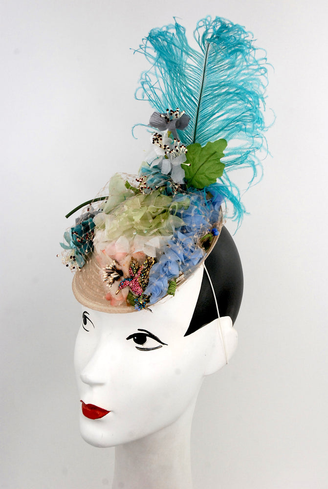 """Birds of a feather"", headpiece with vintage flowers, netting and blue feather"