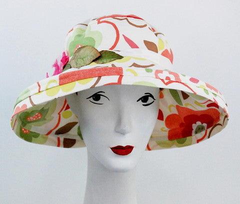 This hat provides a nice shade to the summer sun. Detail is pretty vintage leaves and a pink vintage flower. Brim keeps shape and fabric is a high end couture cotton