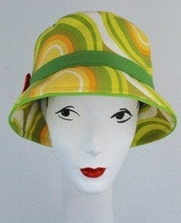 Bucket hat in yellow and green sixties inspired design with orange buckle