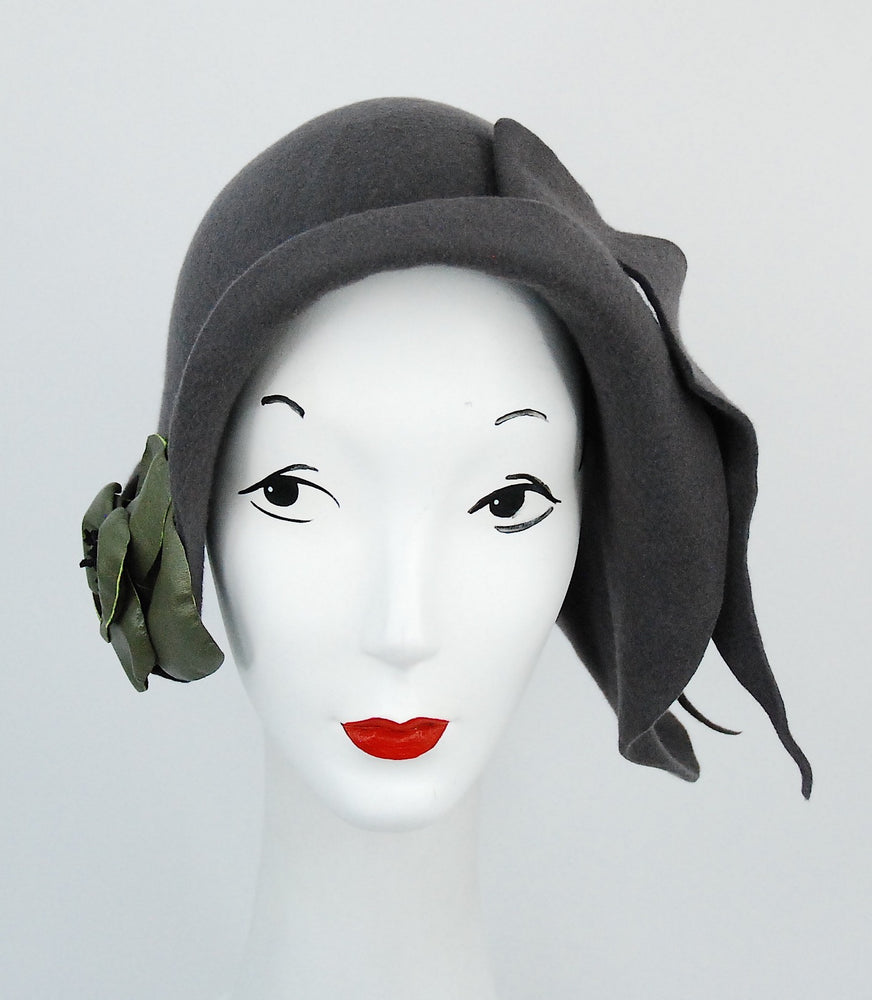 Grey fur felt sculpted hat with leather flower