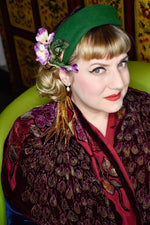 Green sculpted wool headband style with velvet flowers