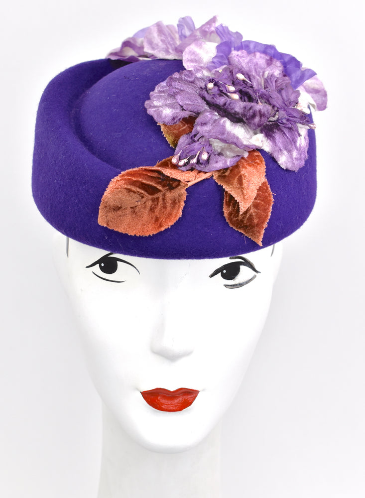 Stunning purple pillbox style wool hat with velvet detail.
