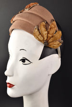 Sculpted wool headband style with beaded trims