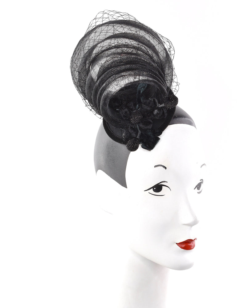 Black swirls stylish event headpiece with black velvet leaves