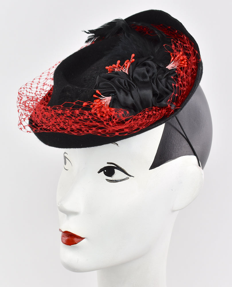 Black wool headpiece with red netting overlay,black velvet and ribbon
