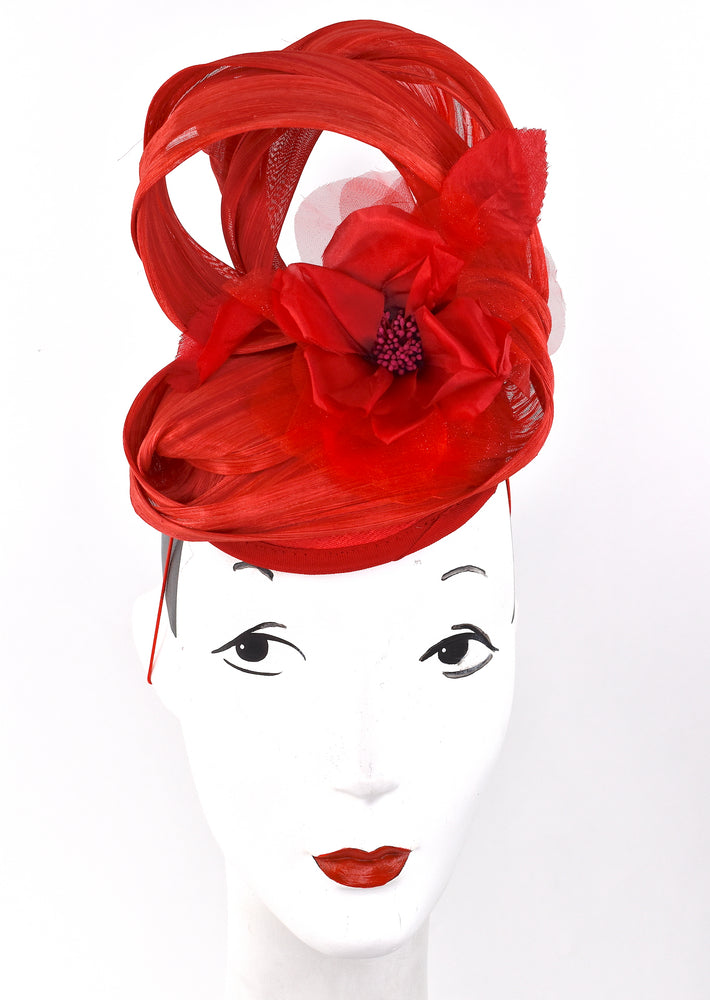 Red sculpted headpiece with red silk flower