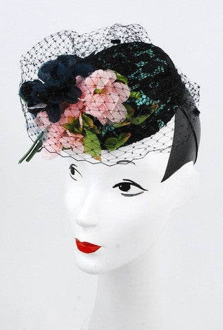 Lace and vintage flower pillbox with black netting with velvet. Detailed with lace overlay and silk with stunning vintage pink and navy flowers. Truly a work of art!