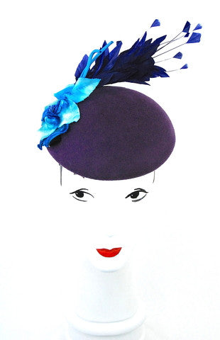 An original design ,this purple wool blocked beret is adorned with a blue vintage velvet flower
