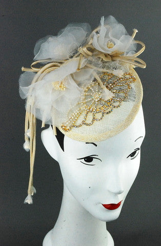 Ivory sinamay headpiece with silk flowers in off white  and rhinestone appliqué.