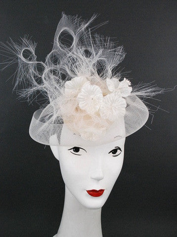 Stand tall in this stunning white and off white artistic headpiece, made for the gal who wants something different. White horsehair ribbon with satin flowers