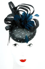 Spotted sinamay beret is styled with a navy coloured feather flower