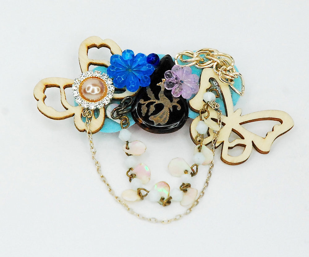 Unique brooch with wood butterflies