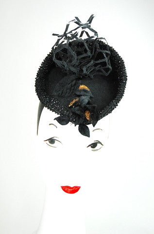 This headpiece is amazing on! Blocked wool with vintage veiling from Paris and beaded trim around Attaches with hair clips.