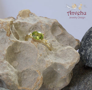 Oval Peridot 7x5 Gold Ring with side diamonds