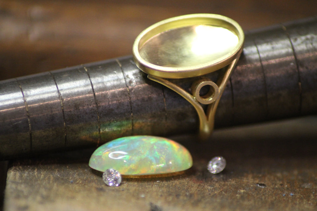 Rare Ethiopian opal ring with brilliant cut diamonds about to be set, design process photograph