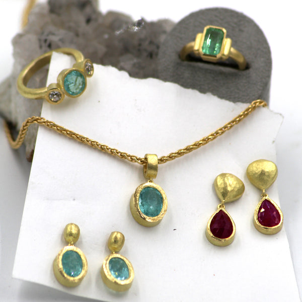 Selection of finish pieces featuring Paraiba tourmaline, ruby and diamonds