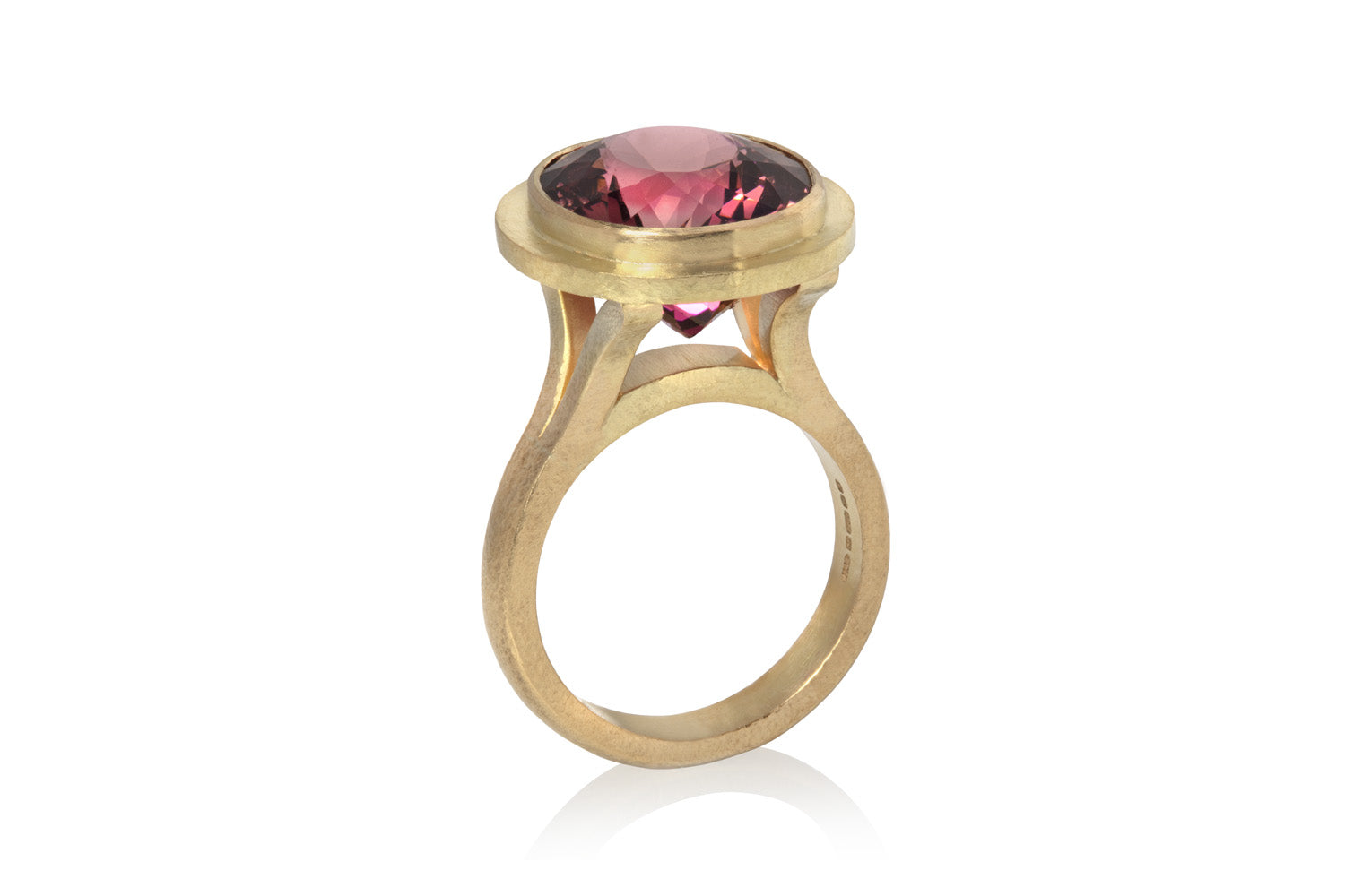 Pink tourmaline ring in textured yellow gold
