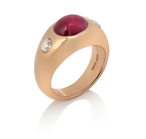 Large smooth yellow gold ring with gypsy set ruby cabochon, and two rose cut diamonds
