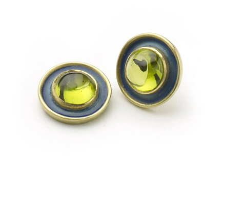 Yellow gold stud earrings set with peridot cabochons with blue enamel borders