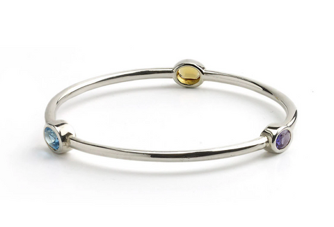 Silver bangle set with citrine, blue topaz and amethyst