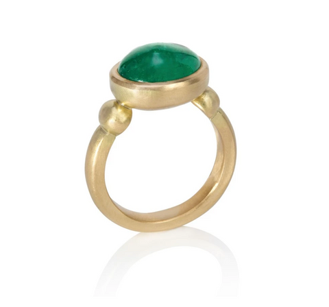 Yellow gold ring set with large oval emerald cabochon