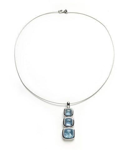 White gold necklace of aquamarine cabochons set in white gold on flexible torque