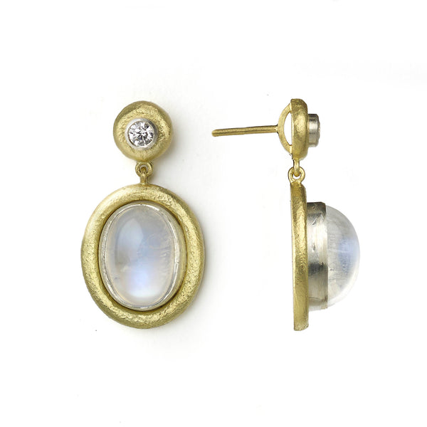 Moonstone cabochon earrings with diamonds, all set in white gold with textured yellow gold borders