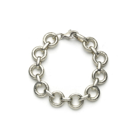 Silver bracelet with beaten round links alternately linked with smooth oval links