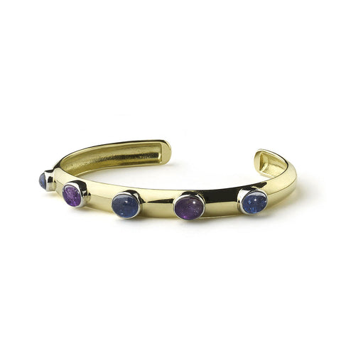Yellow gold bangle set with blue and purple sapphires in white gold rub-over settings