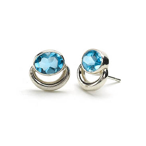 Silver bull ring style stud earrings set with oval blue topaz