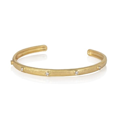 Beaten yellow gold bangle, set with round cut diamonds