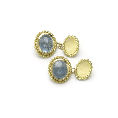Yellow gold cufflinks set with oval aquamarine cabochons, with twisted yellow gold borders