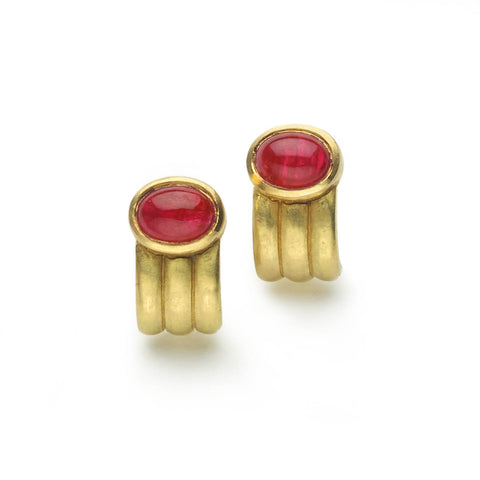 Oval ruby cabochons set in yellow gold ridged 'half hoop' design