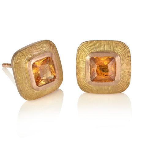 Orange cushion cut sapphires set in wide red gold engraved borders
