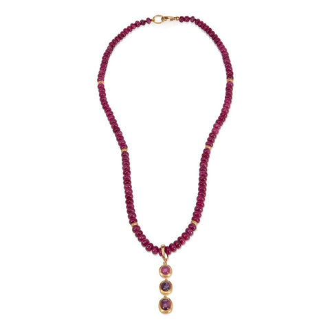 Ruby cabochon bead necklace with detachable star ruby pendant, on white background
