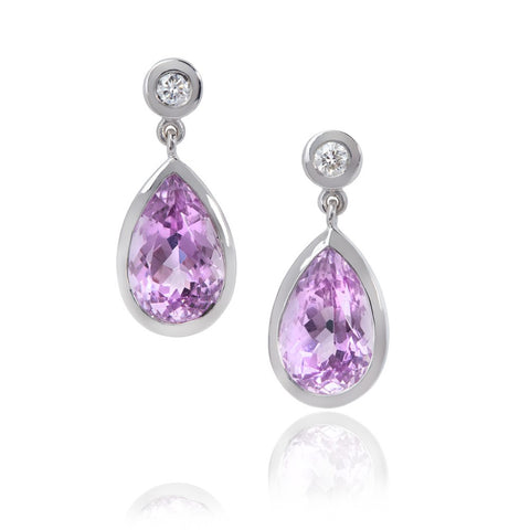 Pear shaped kunzite drops, set in white gold, with diamond stud tops