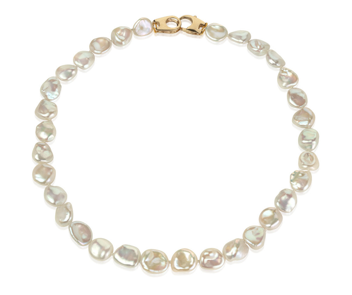 Keshi pearl necklace with 18ct gold clasp on white background