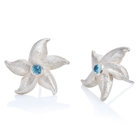 Silver starfish stud earrings set with blue topaz