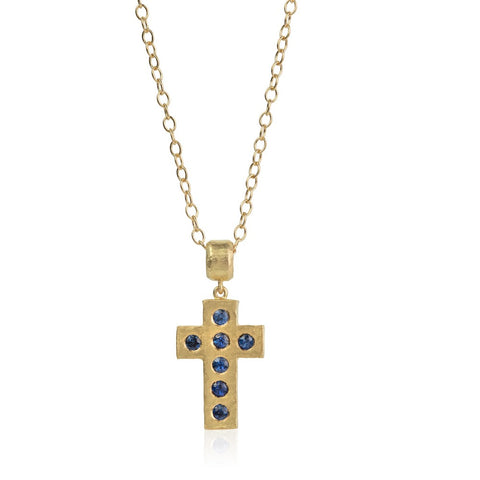 Hammered yellow gold cross, set with round blue sapphires on a gold chain