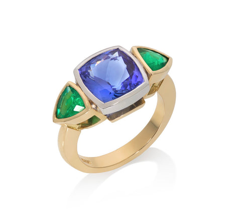Tanzanite and emerald three stone ring set in 18ct yellow and white gold