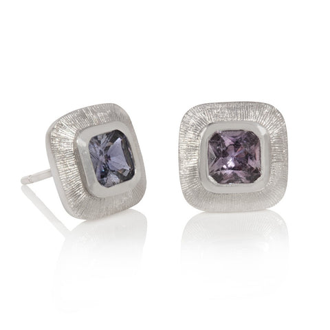 Cushion shaped lilac sapphires set in white gold with line engraving
