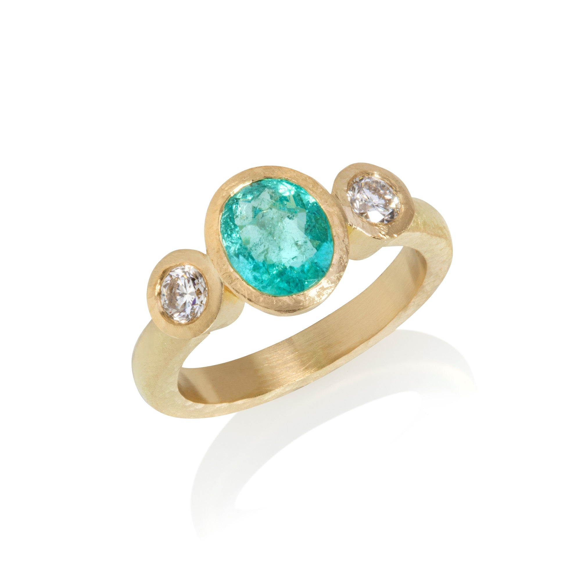 Yellow gold ring with central oval Paraiba tourmaline with round cut diamonds either side