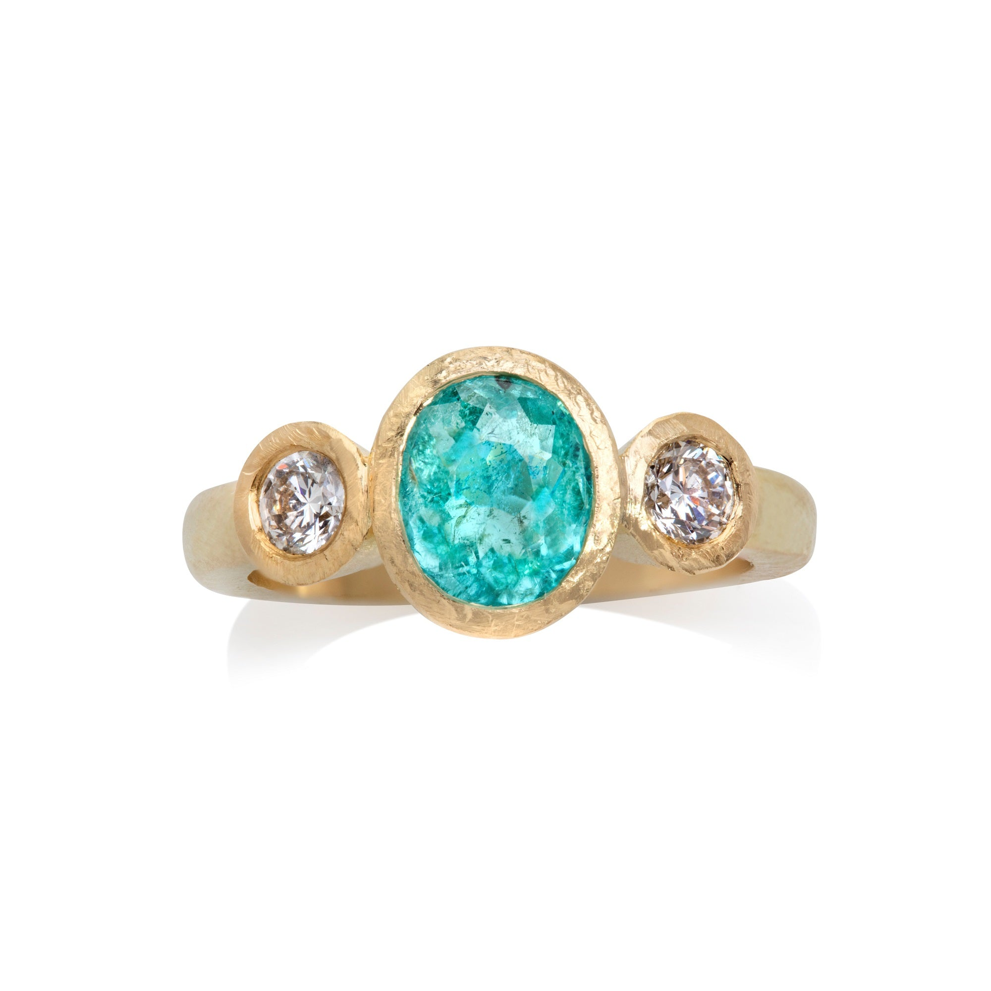 Yellow gold ring viewed from above with central oval Paraiba tourmaline with round cut diamonds either side