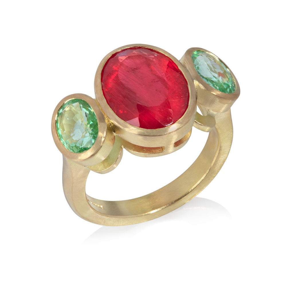 Ring of large oval rhodonite, set in yellow gold, between two oval green Paraiba tourmalines