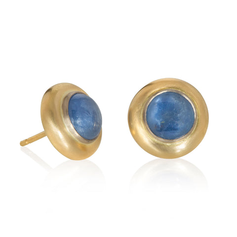 Stud earrings with sapphire cabochons set in yellow gold on white background