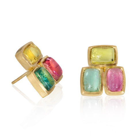Multi-coloured tourmaline cabochons set in yellow gold