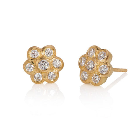 18ct yellow gold diamond daisy stud earrings on white background