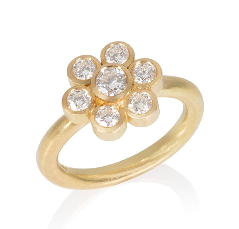 18ct yellow gold diamond ring set in a daisy motif.