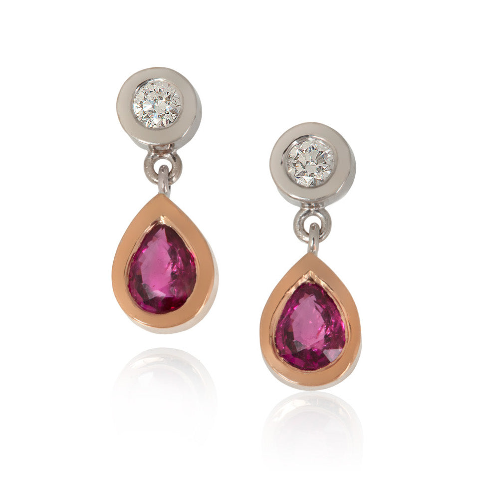 Round diamonds set in white gold, with pear shaped ruby drops set in red gold