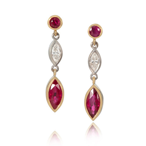 Ruby and diamond drop earrings on white background